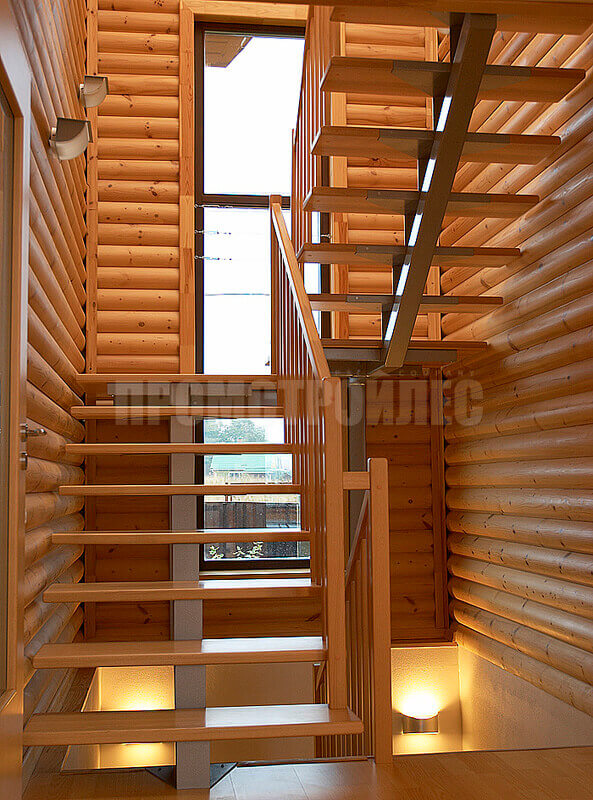 The staircase in the house of glued logs