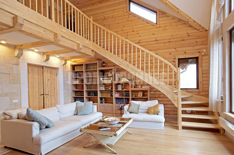 Stairs in the interior of houses from glued beams